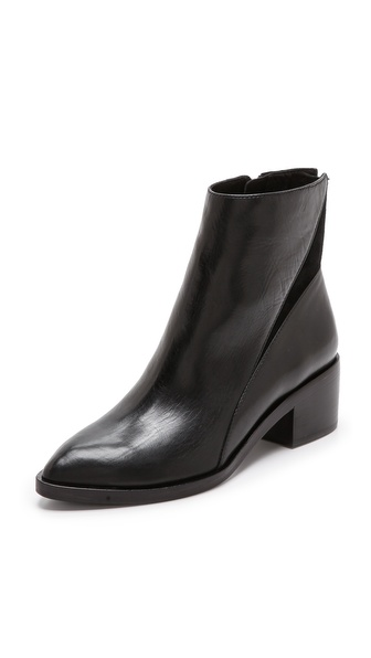 Shop Sigerson Morrison online and buy Sigerson Morrison Scarlett Flat Booties - Black - Velvety suede offers a rich contrast to sleek, polished leather on lean Sigerson Morrison booties. The toe tapers to a structured almond point, and a polished pull accents the concealed side zip. Stacked heel and leather sole. Leather: Cowhide. Imported, China. This item cannot be gift boxed. Measurements Heel: 2in / 50mm Shaft: 5.5in / 14cm. Available sizes: 6,6.5,7,7.5,8,9,9.5,10