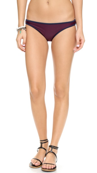 Shop Solid & Striped online and buy Solid & Striped Miranda Bikini Bottoms Burgundy-Navy - Contrast tones detail these Solid & Striped bikini bottoms. Shell: 80% polyamide/20% elastane. Lining: 90% polyamide/10% elastane. Hand wash. Imported, Morocco. Available sizes: L,S,XS