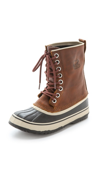 Kupi Sorel cipele online i raspordaja za kupiti Timeless Sorel boots in oil rubbed leather, styled with a rugged waterproof rubber shell. Removable felt lining. Lace up closure and lug sole. Leather: Cowhide. Imported, China. This item cannot be gift boxed. Measurements Heel: 0.5in / 12mm Shaft: 9in / 23cm Circumference: 12.25in / 31cm. Available sizes: 5.5,6,6.5,7,7.5,8,8.5,9,9.5,10,11