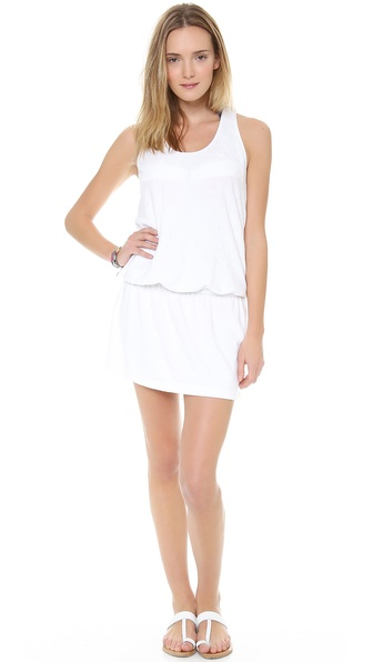 Shop Splendid online and buy Splendid Signature Terry Cover Up Dress White - A terrycloth cover up dress features casual racer back styling. Elastic cinches the waist, creating volume in the bodice. Scoop neckline. Fabric: Terrycloth. 43% pima cotton/43% viscose/14% polyester. Hand wash. Made in the USA. MEASUREMENTS Length: 33.5in / 85cm. Available sizes: L