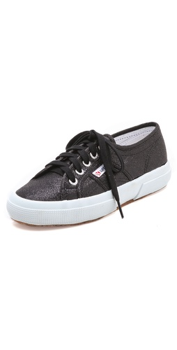 Kupi Superga cipele online i raspordaja za kupiti Lamé canvas makes a shimmering statement on these classic Superga sneakers. Textured rubber sole.  Imported, Vietnam. This item cannot be gift-boxed. - Black