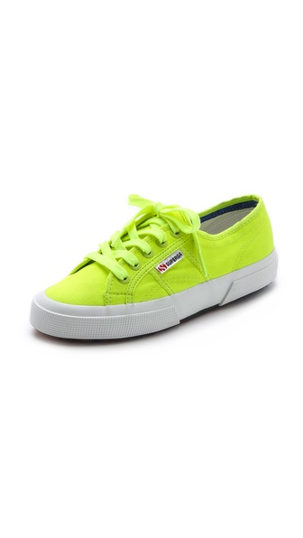 Kupi Superga cipele online i raspordaja za kupiti Signature Superga sneakers are updated in electric neon canvas. Tonal ties lace through logo embossed grommets, and the wide rubber sidewall provides a sturdy foundation. Crepe sole. Imported, Vietnam. This item cannot be gift boxed. Available sizes: 9,9.5,10