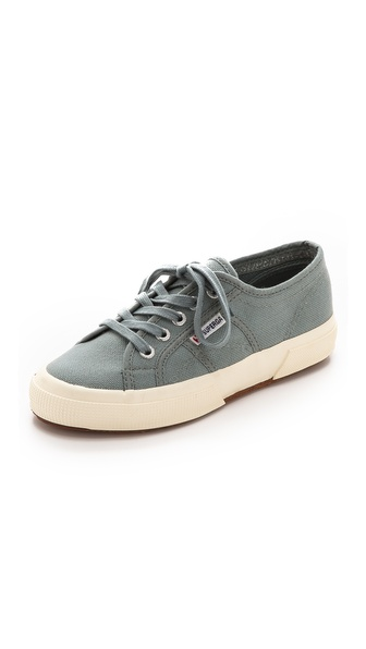 Kupi Superga cipele online i raspordaja za kupiti A lace up closure over an inset elastic panel lends classic style to slip on Superga sneakers. Textured rubber sidewall. Crepe sole. Imported, Vietnam. This item cannot be gift boxed. Available sizes: 6.5,7.5,8,8.5,9,9.5,10