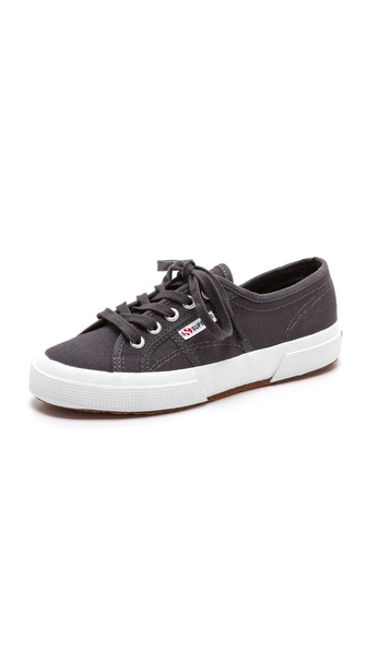 Kupi Superga cipele online i raspordaja za kupiti A lace up closure over an inset elastic panel lends classic style to slip on Superga sneakers. Textured rubber sidewall. Crepe sole. Imported, Vietnam. This item cannot be gift boxed. Available sizes: 6,6.5,7,7.5,8,8.5,9,9.5,10