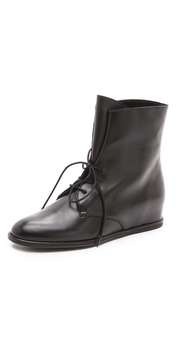 Stuart Weitzman Stepmistress Hidden Wedge Booties at Shopbop / East Dane