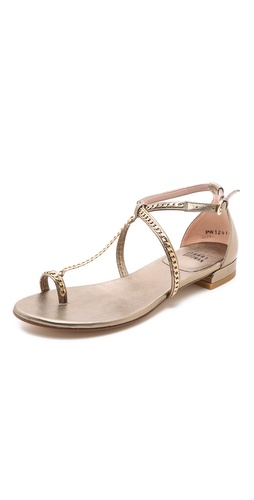 Kupi Stuart Weitzman cipele online i raspordaja za kupiti Polished curb chain lends an elegant touch to simple, metallic-leather Stuart Weitzman sandals. Buckle ankle strap. Leather sole.  Leather: Sheepskin. Made in Spain. This item cannot be gift-boxed. - Ale