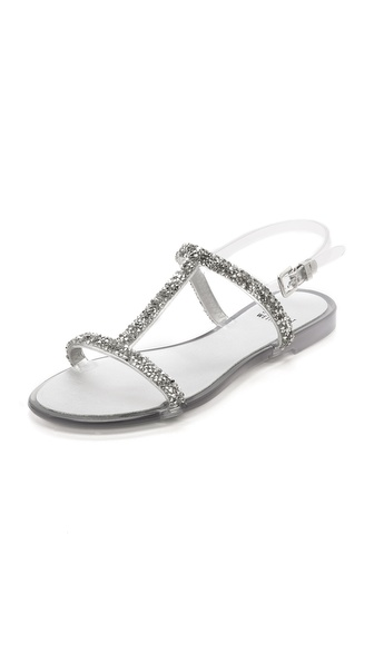 Kupi Stuart Weitzman cipele online i raspordaja za kupiti Slender rubber straps encrusted with metallic and clear crystals lend playful shine to T strap Stuart Weitzman sandals. Buckle closure. Rubber sole. Made in Italy. This item cannot be gift boxed. Available sizes: 5,6,7,8,9,10
