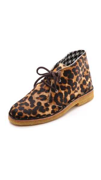 Kupi Studio Pollini cipele online i raspordaja za kupiti Leopard print faux haircalf brings graphic edge to casual Studio Pollini booties. Soft crepe rubber cushions the sole. Lace up closure. Fabric: Faux haircalf. Made in Italy. This item cannot be gift boxed. Measurements Heel: 1in / 25mm. Available sizes: 35,36,37,38,39,40,41