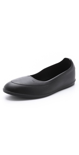 Shop SWIMS online and buy SWIMS Classic Galoshes - A refined version of classic overshoes from the designers at SWIMS. The protective rubbers have nylon lining for insulation and on and off ease. The durable outsole provides traction.  Imported, Vietnam. This item cannot be gift-boxed. - Black