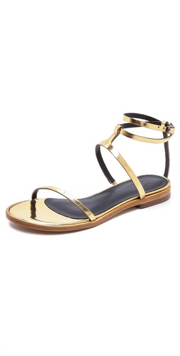 Kupi Tibi cipele online i raspordaja za kupiti Simple, yet sophisticated Tibi sandals constructed from bands of polished metallic leather. Buckle ankle strap. Padded footbed and leather sole.  Leather: Cowhide. Made in Brazil. This item cannot be gift-boxed. - Pale Gold