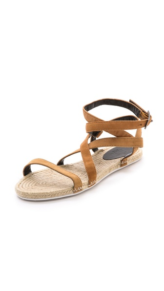 Kupi Tibi cipele online i raspordaja za kupiti Simple suede Tibi sandals with wraparound straps and a casual braided footbed. Buckle closure. Rubber sole. Leather: Goatskin. Made in Brazil. This item cannot be gift boxed. Available sizes: 35,37,38,40