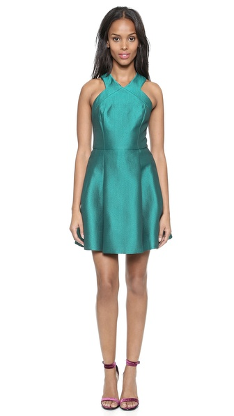 Kupi Tibi haljinu online i raspordaja za kupiti A lustrous sheen gives this Tibi mini dress a glamorous look. Asymmetrical pleats add gentle volume, and the double V neckline dips to the exposed back zip. Hip pockets. Lined. Fabric: Lustrous jacquard. Shell: 58% polyester/17% acrylic/17% wool/8% acetate. Lining: 100% acetate. Dry clean. Imported, China. Measurements Length: 33in / 84cm, from shoulder Measurements from size 2. Available sizes: 0,2,4,6,8,10,12