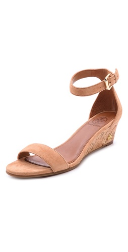 Shop Tory Burch online and buy Tory Burch Savannah Wedge Sandals - Velvety suede straps provide a sophisticated contrast to a casual cork wedge on texture-rich Tory Burch sandals. Buckle ankle strap. Rubber sole.  Leather: Sheepskin. Imported, China. This item cannot be gift-boxed.  Measurements  Heel: 2in / 50mm - Capri Tan