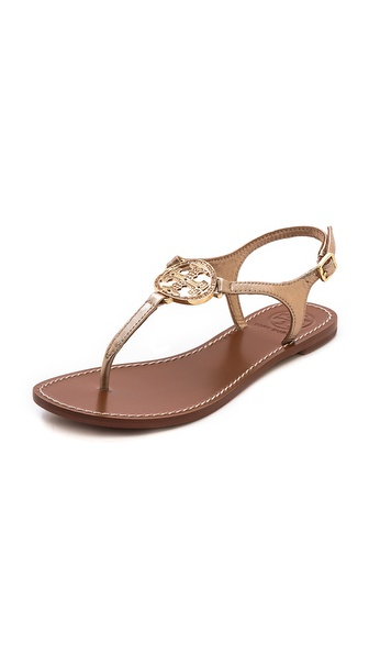 Kupi Tory Burch cipele online i raspordaja za kupiti Tonal crystals accent the logo medallion on metallic leather Tory Burch sandals. A polished buckle secures the slender ankle strap. Leather sole. Leather: Sheepskin. Imported, China. This item cannot be gift boxed. Available sizes: 5,6,6.5,7,7.5,8,8.5,9,9.5,10
