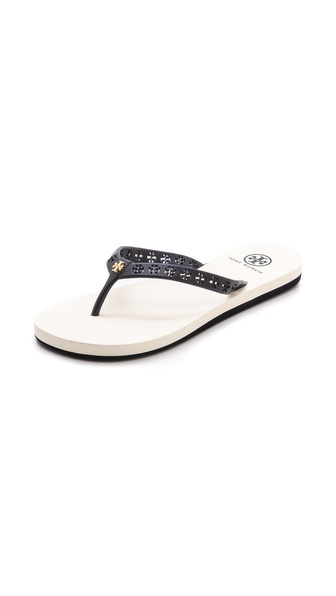 Kupi Tory Burch cipele online i raspordaja za kupiti Logo cutouts accent the rubber straps of casual Tory Burch flip flops. Stacked foam footbed and rubber sole. Imported, China. This item cannot be gift boxed. Available sizes: 5,6,7,8,9,10