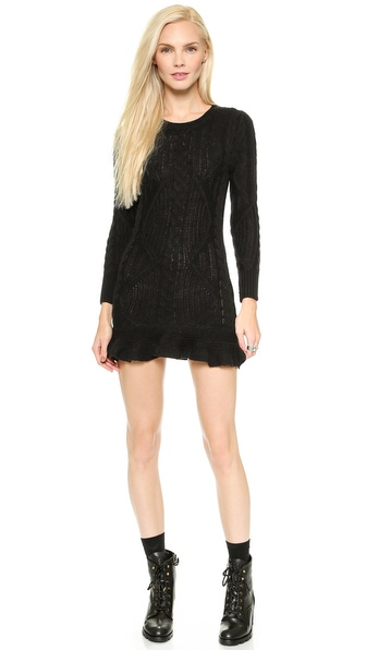 Shop UNIF online and buy Unif Alleger Dress Black - This knit UNIF sweater dress gains feminine charm from a narrow profile and ruffled hem. Ribbed edges and long sleeves. Unlined. Fabric: Cable knit. 100% acrylic. Hand wash. Imported, China. Measurements Length: 30in / 76cm, from shoulder Measurements from size S. Available sizes: M