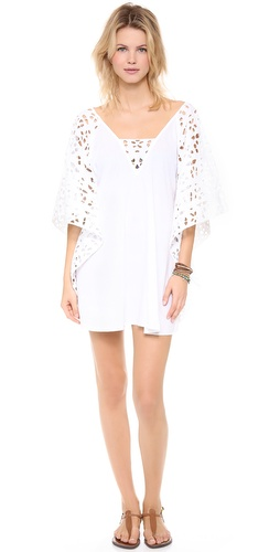 Shop Vix Swimwear online and buy Vix Swimwear Solid White Nepal Caftan - FREE SHIPPING at shopbop.com. An airy cover-up in a delicate mix of voile and eyelet. Short batwing sleeves. Semi-sheer.  Fabric: Voile. 100% cotton. Hand wash. Imported, India.  MEASUREMENTS Length: 31in / 78.5cm, from shoulder - Solid White