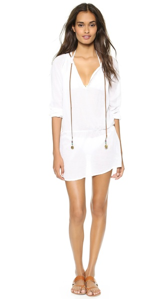 Shop Vix Swimwear online and buy Vix Swimwear Sofia By Vix Caftan White - Airy gauze composes this Vix Swimwear cover up caftan. Beaded leather drawstrings open the split neckline, and elastic shapes the waist and cuffs. Fabric: Gauze. 100% cotton. Hand wash. Imported, India. Measurements Length: 29.25in / 74cm, from shoulder Measurements from size S. Available sizes: M