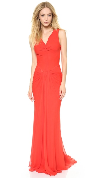Shop Vera Wang Collection online and buy Vera Wang Collection V Neck Draped Gown Geranium - A vibrant hue amps up a glamorous Vera Wang collection gown, which cuts a romantic silhouette in filmy silk chiffon. Pleating ripples through the double V neckline and waist, and a pleated train adds a touch of drama. Raw edged trim. Sleeveless. Lined. Fabric: Silk chiffon. 100% silk. Dry clean. Imported, China. Measurements Length: 63in / 160cm, from shoulder Measurements from size 4. Available sizes: 0,2,4,6