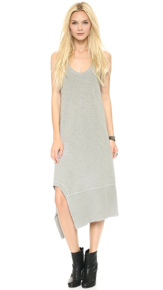 Shop Wilt online and buy Wilt Slub Mix Tank Dress Vintage Pewter - A raw, jagged hem lends a deconstructed look to this Wilt tank dress. Wide and thin ribbing detail the edges. Racer back. Fabric: Slubbed jersey. 100% cotton. Wash cold. Made in the USA. Measurements Length: 35in / 89cm, from shoulder to shortest point Measurements from size S. Available sizes: XS