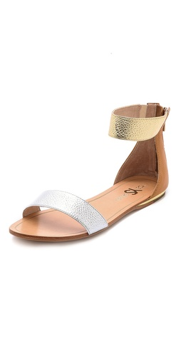 Shop Yosi Samra online and buy Yosi Samra Cambelle Flat Sandals - Minimalist Yosi Samra sandals rendered in colorblocked panels of metallic pebbled leather. Exposed back zip. Rubber sole.  Leather: Cowhide. Imported, China. This item cannot be gift-boxed. - Silver/Gold