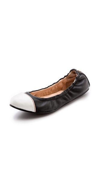 Shop Yosi Samra online and buy Yosi Samra Marni Cap Toe Flats - Black/White - A contrast cap toe lends easy sophistication to leather Yosi Samra ballet flats. Gathered elastic top line and flexible rubber sole. Leather: Cowhide. Imported, China. This item cannot be gift boxed. Available sizes: 5,6,7,8,9,10,11