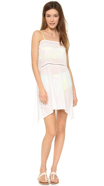 Shop Zinke online and buy Zinke Gwen Dress White - Delicate lace strikes through gossamer voile on this Zinke cover up dress. Self tie grosgrain shoulder straps. High low hem. Sheer. Fabric: Voile. Shell: 100% cottom. Hand wash. Made in the USA. Measurements Length: 39in / 99cm, from shoulder Measurements from size S. Available sizes: L,M,S