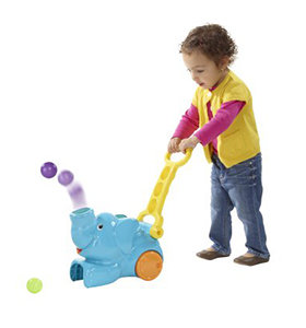 Steering the toy over balls helps little ones to practice gross motor skills.