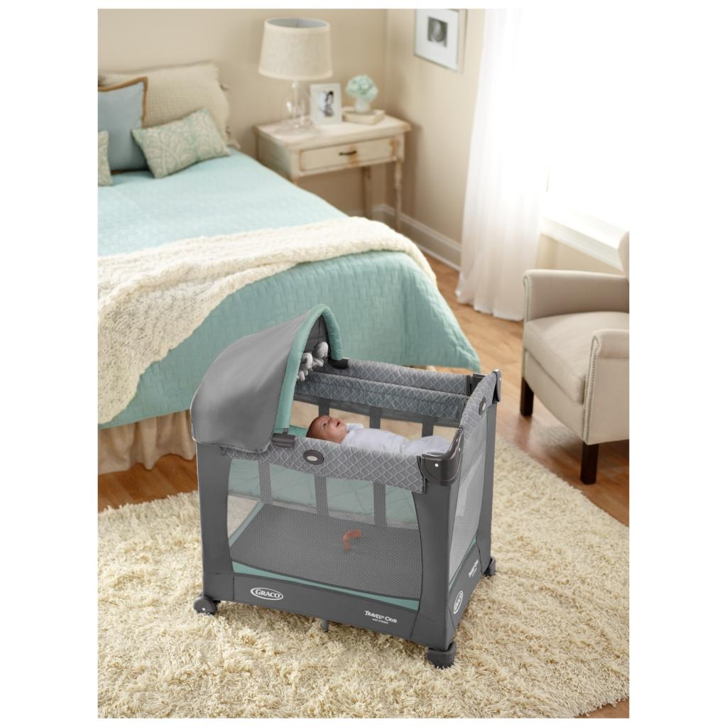 new graco travel lite crib with stages manor portable. Black Bedroom Furniture Sets. Home Design Ideas