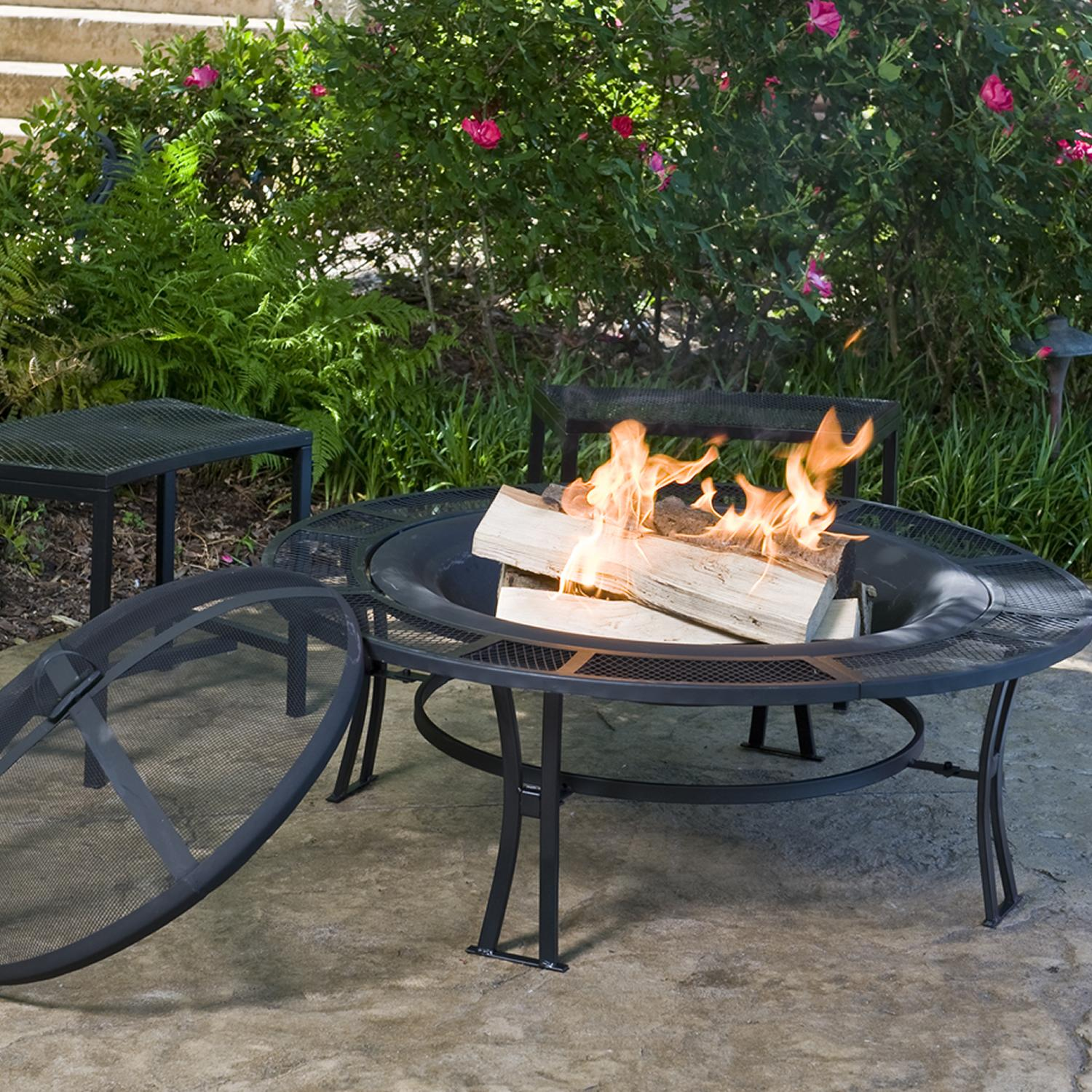 Cobraco steel fire pit and bench set in use Fire pit benches