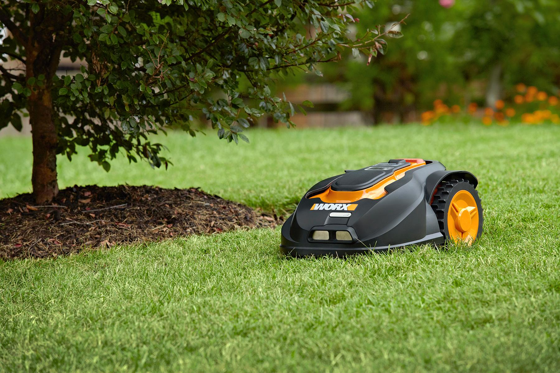 Worx landroid robotic lawn mower 28 volt for Lawn mower cutting grass