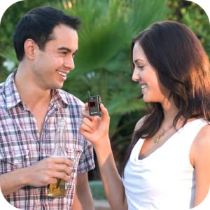 Couple using BACtrack Keychain Breathalyzer