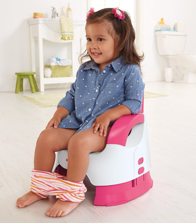 Cute little girl sitting on potty - People, children