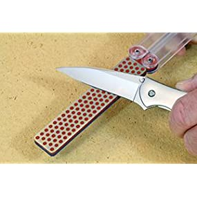 Diafold sharpener with knife