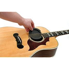Screeching Halt sitting in a guitar sound hole.
