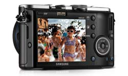Samsung NX100 14.6 Megapixel Interchangeable Lens Digital Camera Including Kit with Flash feature shot