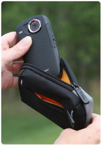 Durable nylon camcorder case with zippered pocket.