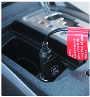 The heated seat cushion plugs into your vehicle's 12V power supply