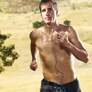 Greg Bennett World Class Triathlete trains with the Surge 2G Waterproof Sport Headphones