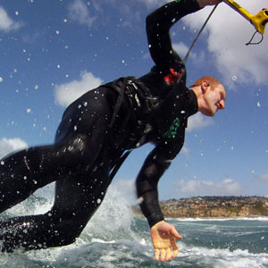 Kitesurfer & Pro H2O Audio Rider Grant Hasselbach surfs with the Surge Sportwraps Waterproof Sport Headphones