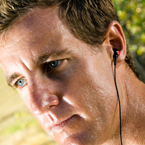Greg Bennett World Class Triathlete wearing the Flex All Sport Waterproof Headphones