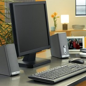 The contemporary look of the silver speakers complements any computer. 