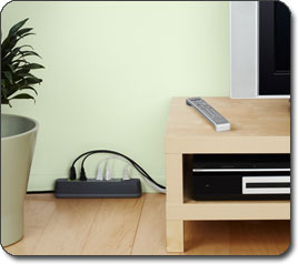 F7C007 Conserve Smart AV Energy Saving Power Strip in a livingroom