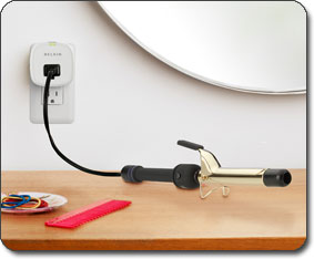 F7C009 Conserve Socket Energy Saving Outlet in a curling iron