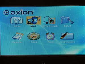 """Select Music icon on the digital picture frame menu and press """"Play"""" button on the remote control"""