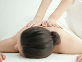 One, Two, or Four Swedish Massages and Aromatherapy