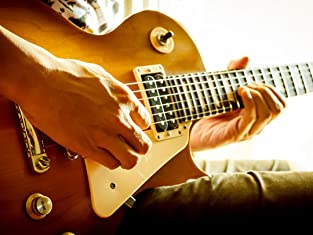 Four or Eight In-Studio Guitar Lessons