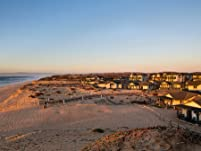 Serene Beachfront Retreat with Bottle of Wine