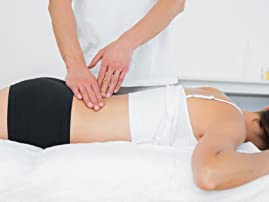 Acupuncture or Massage at Center for Joint/Spine Relief