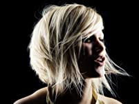 One Women's Haircut with Allover Color or Partial Highlights Included
